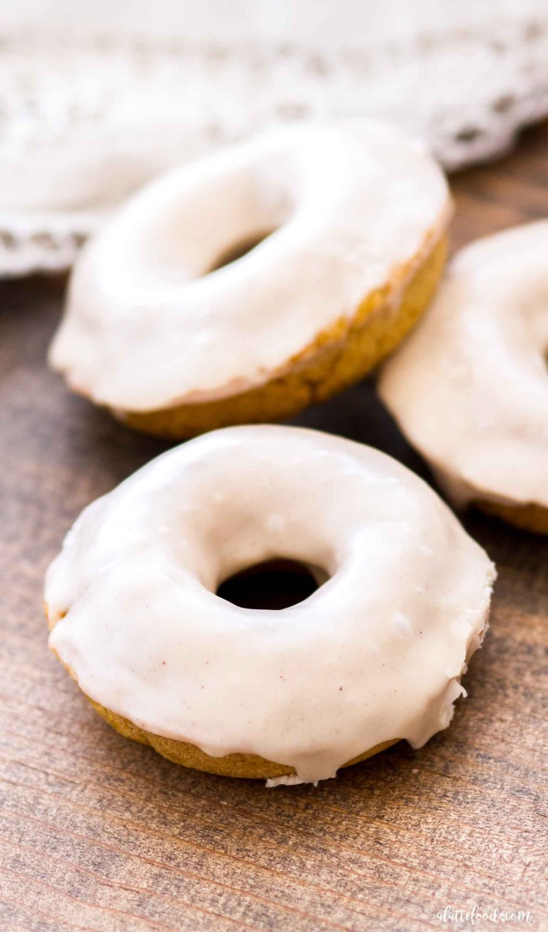 spiced pumpkin donut on brown cutting board