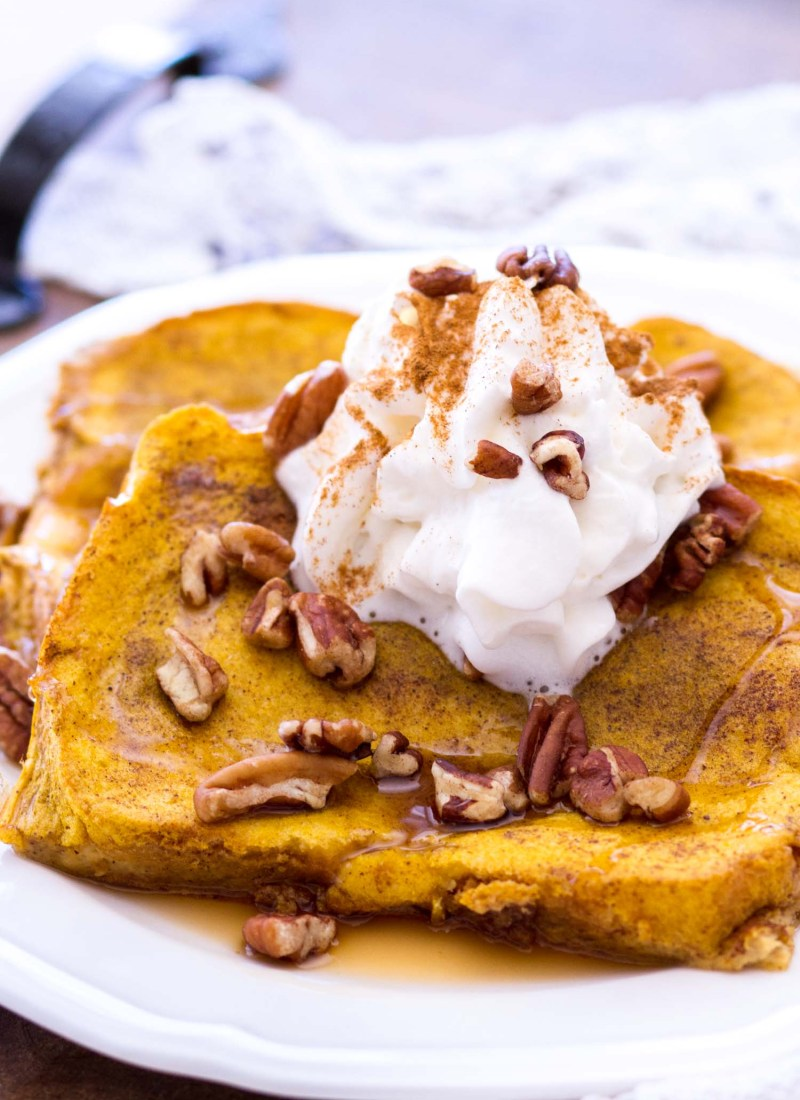 This Easy Pumpkin French Toast Recipe is baked in the oven, making this the perfect fall breakfast! This Pumpkin French Toast Recipe uses thick-cut bread, and is soaked in a rich pumpkin custard and baked to perfection!