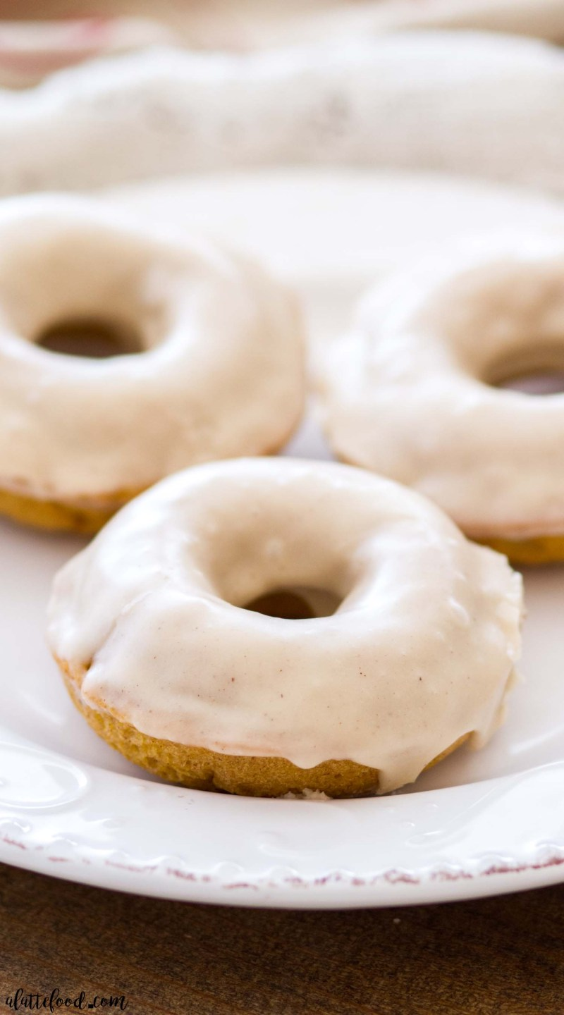These baked Buttermilk Pumpkin Donuts are topped with a maple glaze. These homemade donuts are baked in the oven, giving them a cake donut texture. Between the pumpkin donut flavor and the sweet maple glaze, these make the best fall breakfast!