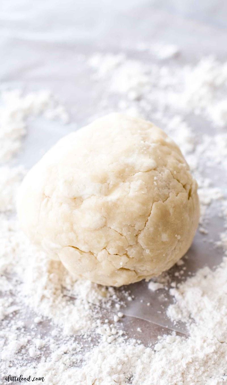 cream cheese pie dough ball in flour
