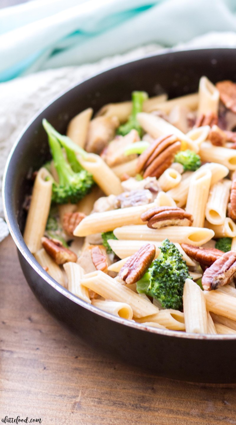 This Pecan, Chicken and Broccoli Pasta is a quick and easy dinner that is perfect for fall! The penne pasta is mixed with chicken and broccoli, and tossed in a light cream sauce (a lightened up version of a traditional cream sauce). The whole dish is topped with chopped pecans, making this easy dinner recipe your new go-to meal!