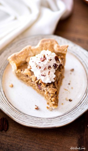 slice of pumpkin apple butter pie with whipped cream