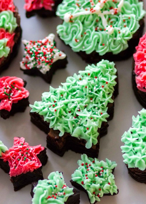 Cutout Frosted Fudge Brownies — This easy last minute Christmas dessert is rich, fudgy, and so fun to make! Rich chocolate brownies are cutout into Christmas shapes and topped with homemade vanilla buttercream frosting! These Cutout Frosted Fudge Brownies are so festive and incredibly rich and chocolatey!
