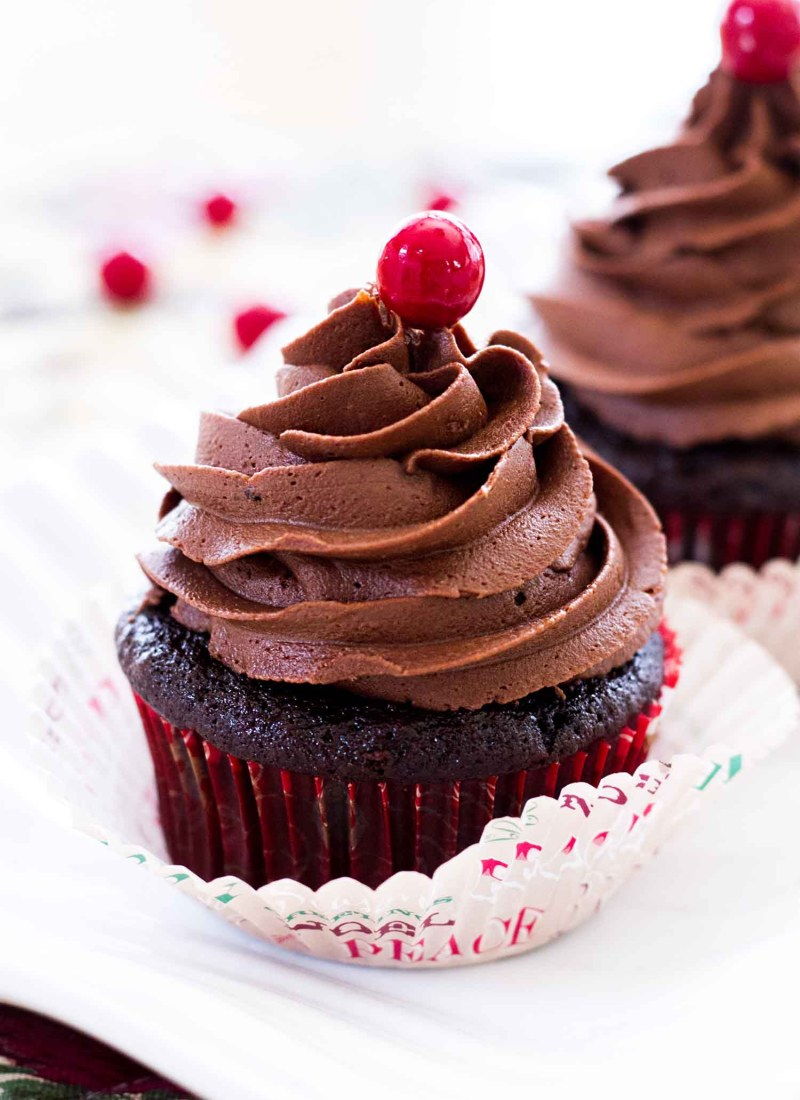 dark chocolate cupcakes with peppermint mocha frosting on white platter