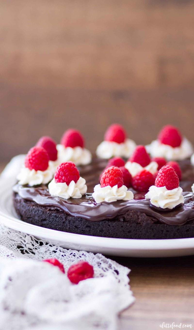 chocolate flourless cake with ganache and raspberries
