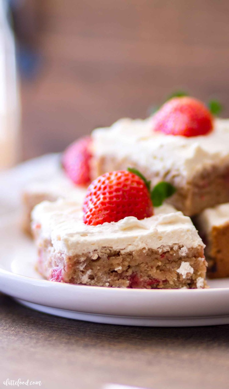 fudgy strawberry blondies with fresh strawberries and cream