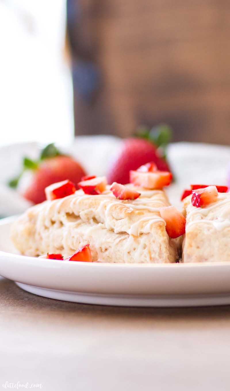 fresh strawberry cream scone on white plate