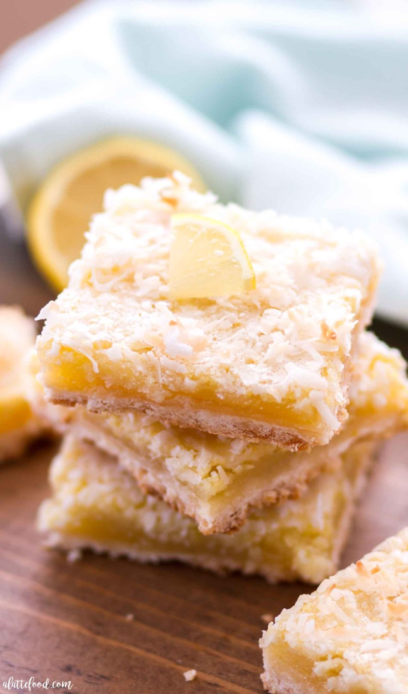These Coconut Lemon Bars are sweet, a little tangy, and have a coconut shortbread crust. Homemade lemon bars are one of my favorite spring desserts, and these Coconut Lemon Bars are a fun twist on the classic lemon bar recipe! Easter dessert perhaps??