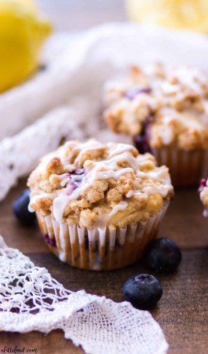 These lemon blueberry crumb cake muffins are light, fluffy, and make the sweetest quick and easy breakfast recipe! These easy lemon blueberry muffins have a sweet crumb cake topping and a tangy lemon glaze on top, making these homemade muffins totally irresistible!