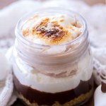 These No Bake S'mores Trifles are a fun twist on the classic summer dessert! These easy s'mores trifles are layers of graham cracker crust, milk chocolate ganache, marshmallow cream filling, and chocolate cream. They are creamy, dreamy, and oh-so-decadent! no bake s'mores recipe, s'mores trifle recipe