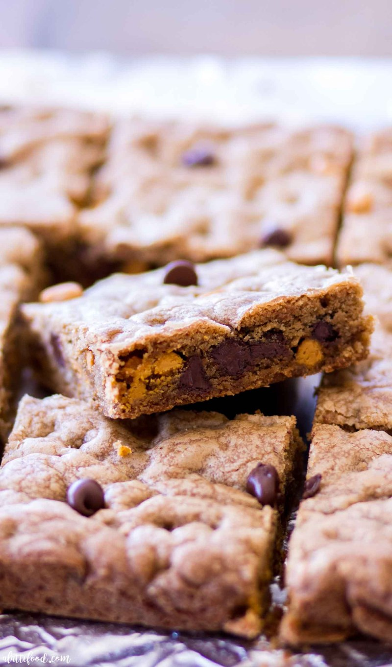 cookie bars with chocolate chips and butterscotch stacked