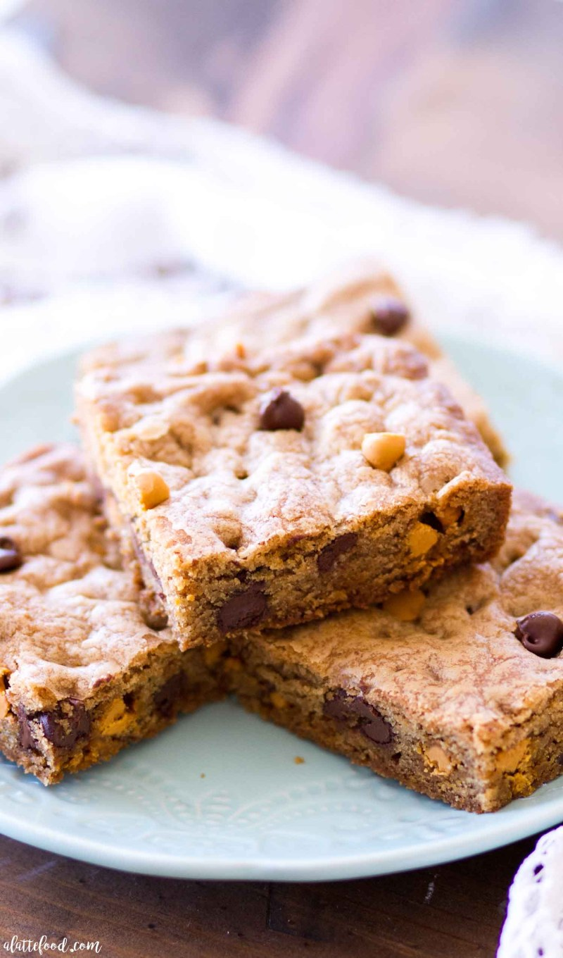 blue plate with made butterscotch chocolate chip cookie bars