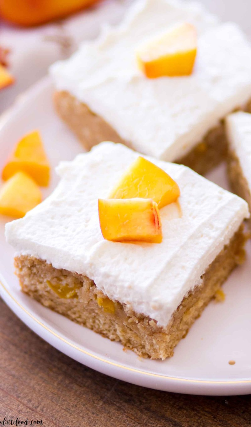 side view shot of peach pie blondies on white and gold plate