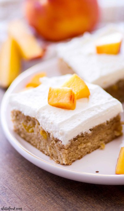These summery peach pie blondies are topped with a sweet homemade whipped cream frosting and fresh peaches! These rich brown sugar blondies totally taste like a brown sugar peach pie in a chewy bar form. A sweet and easy summer dessert recipe!