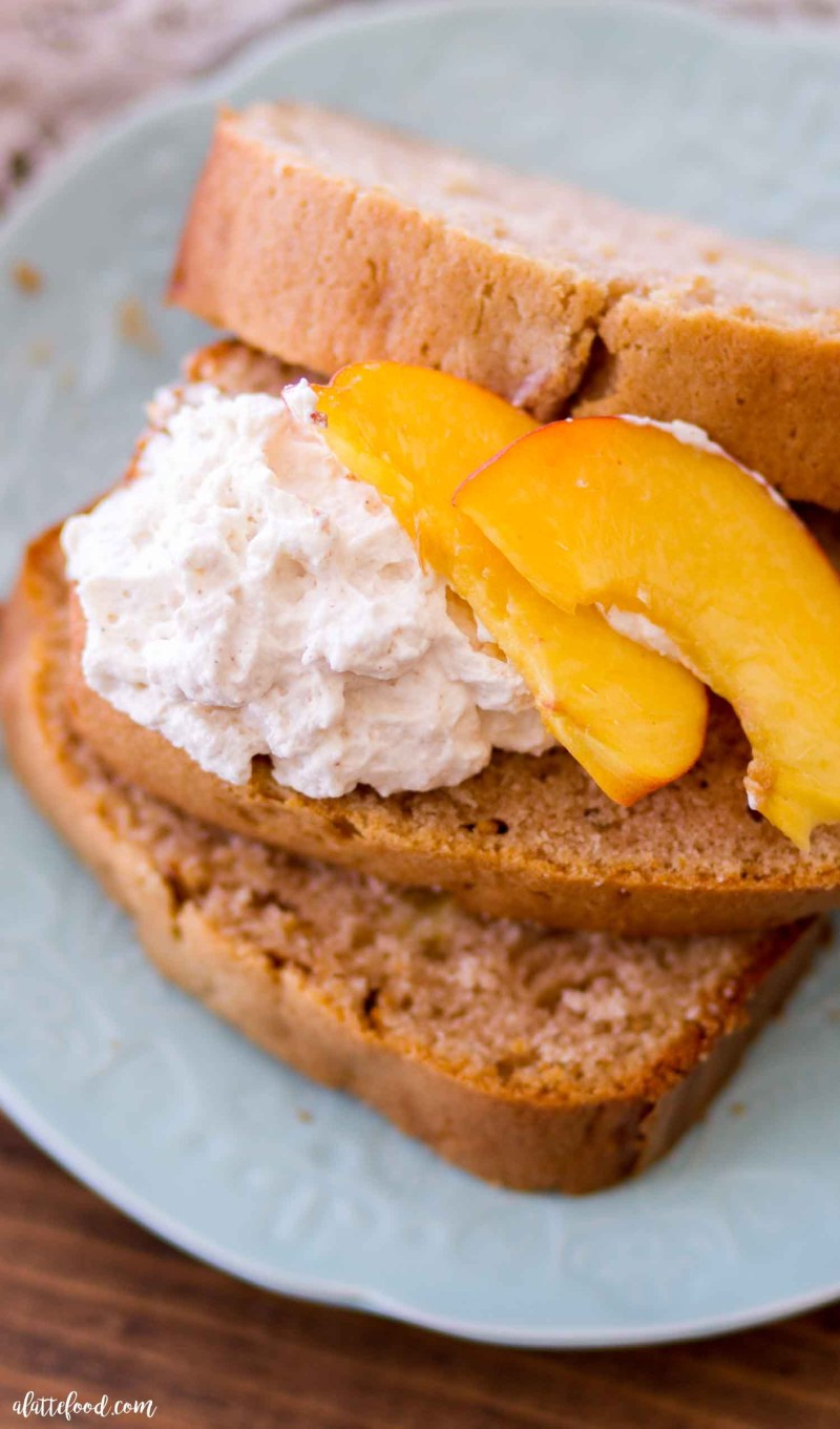 peach pound cake with fresh peaches on blue plate