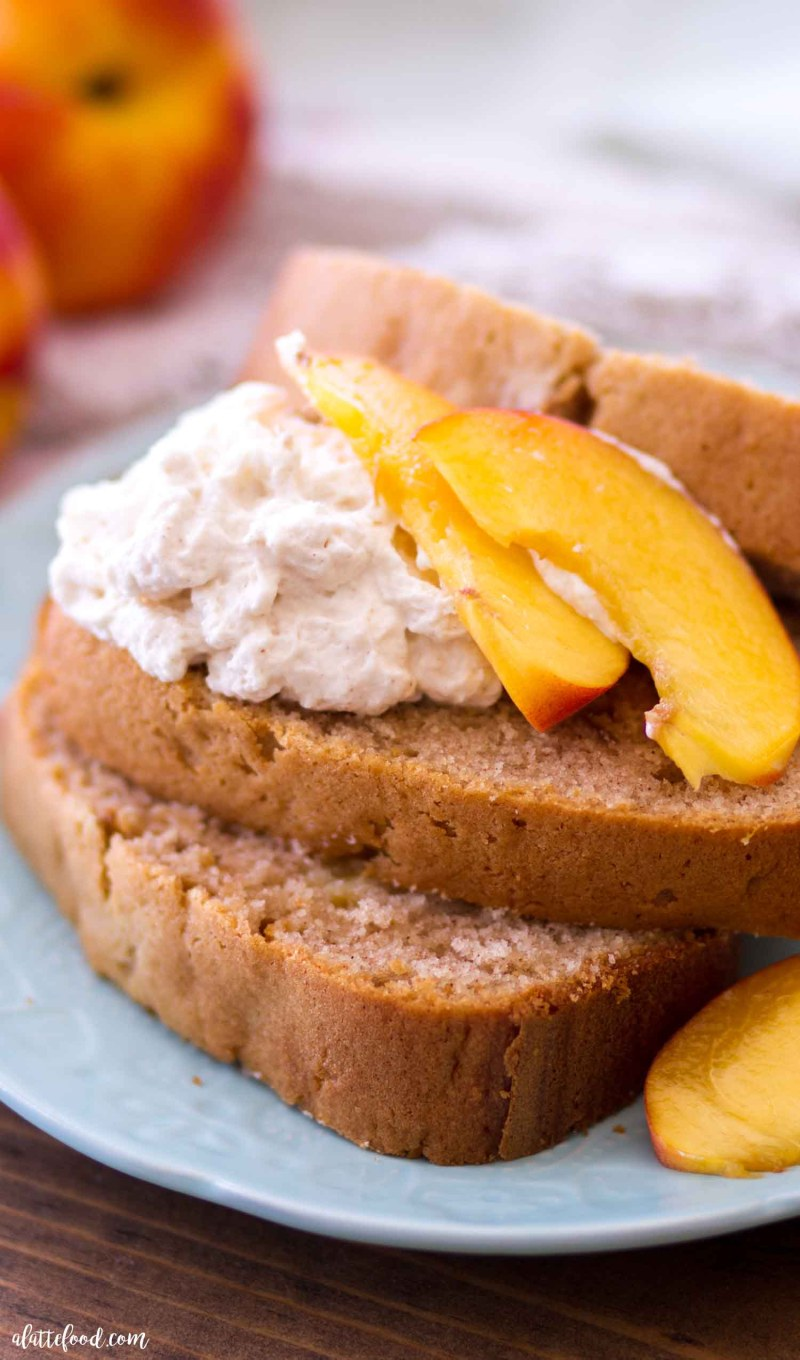 peach pound cake slices with whipped cream and peaches