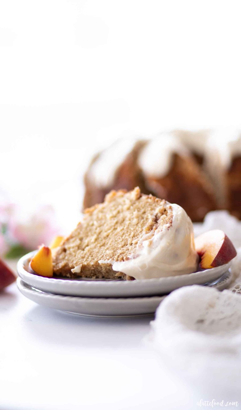 cream cheese peach pound cake on gray plate