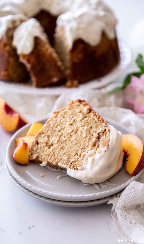 slice of peach pound cake on gray plates