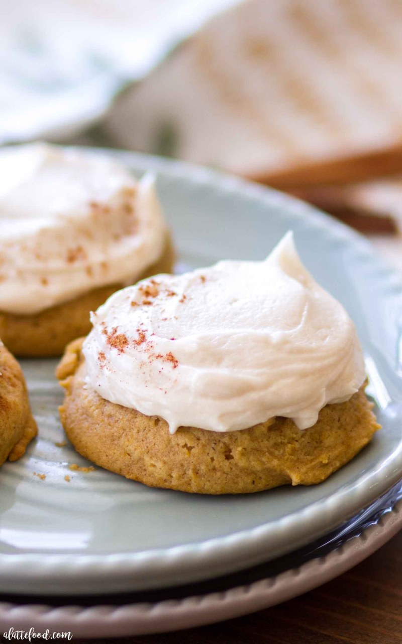 The Best Soft Pumpkin Cookies topped with a maple frosting! They practically melt in your mouth!