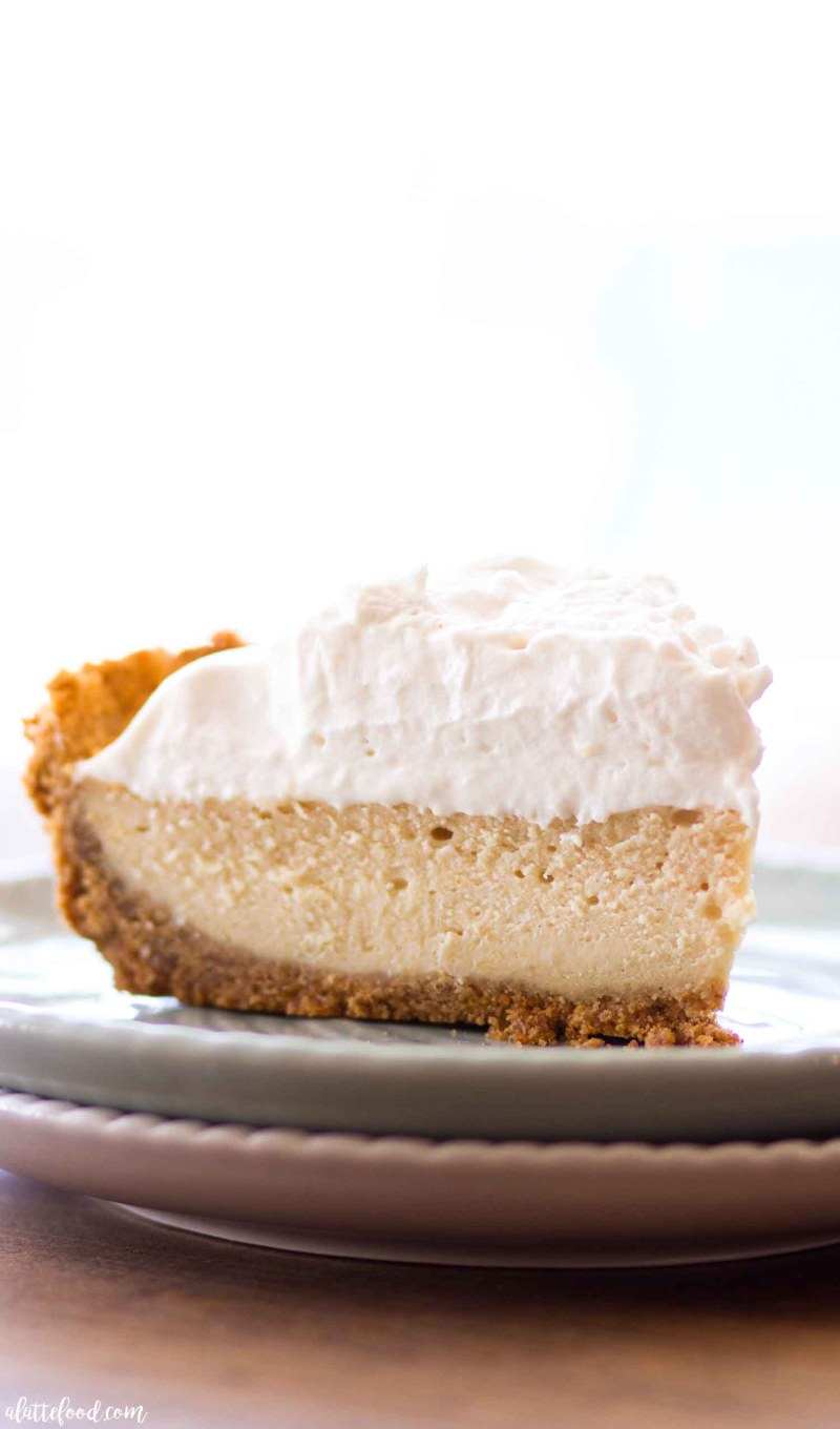 The best easy caramel cheesecake with pecans and homemade whipped cream!