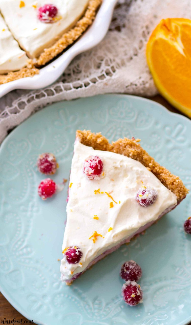 This No Bake Cranberry Orange Cream Pie is sweet, creamy, and perfectly dreamy. An easy cranberry orange sauce is swirled with an orange cream filling and topped with homemade orange whipped cream. This no bake holiday dessert frees up the oven space while still being full of fall and winter flavors.