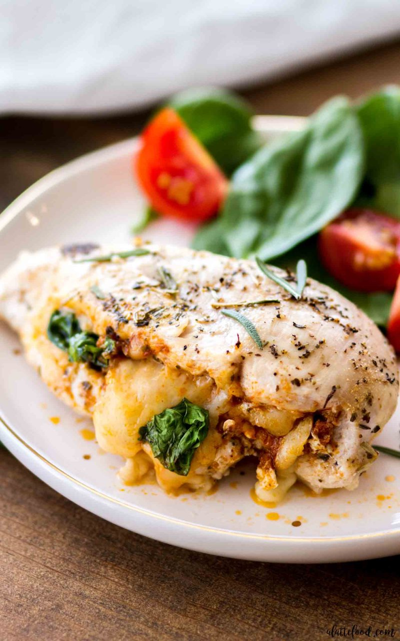 These Tuscan inspired Sun Dried Tomato Stuffed Tuscan Chicken Breasts are so easy yet make an elegant dinner!