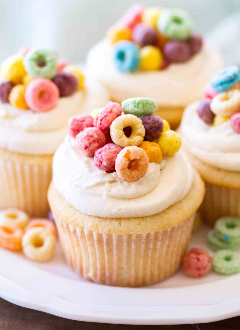 These Cereal and Milk Cupcakes are topped with a cereal milk buttercream. Homemade vanilla cupcakes get a sweet fruit loop cereal milk twist, making these cereal cupcakes a dessert must!