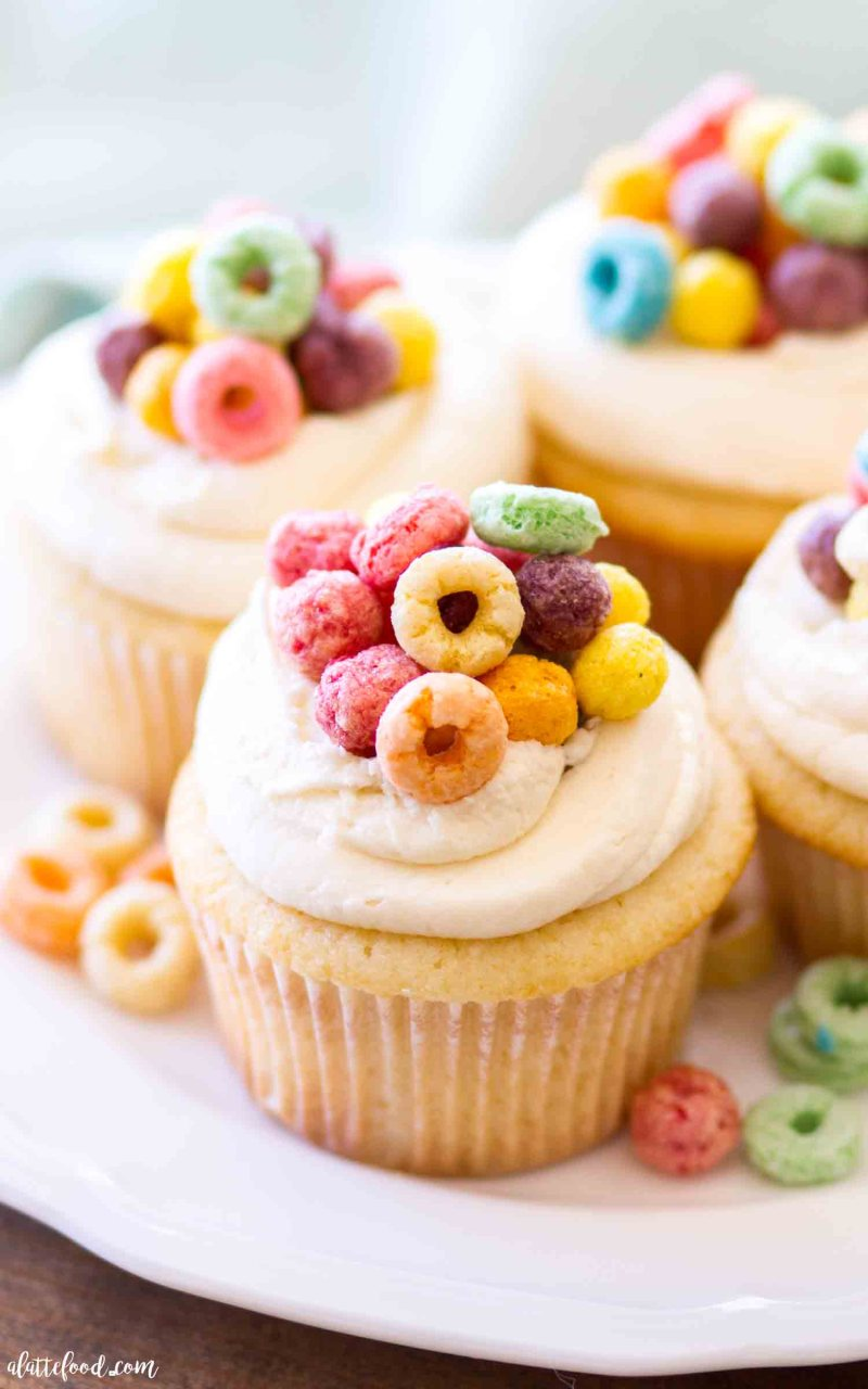 Homemade Cereal and Milk Cupcakes are topped with a cereal milk buttercream. Homemade vanilla cupcakes with cereal.