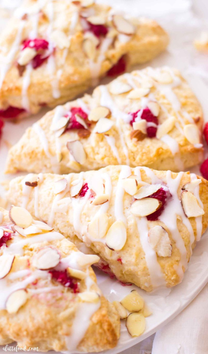 raspberry almond scones with glaze and toasted almonds