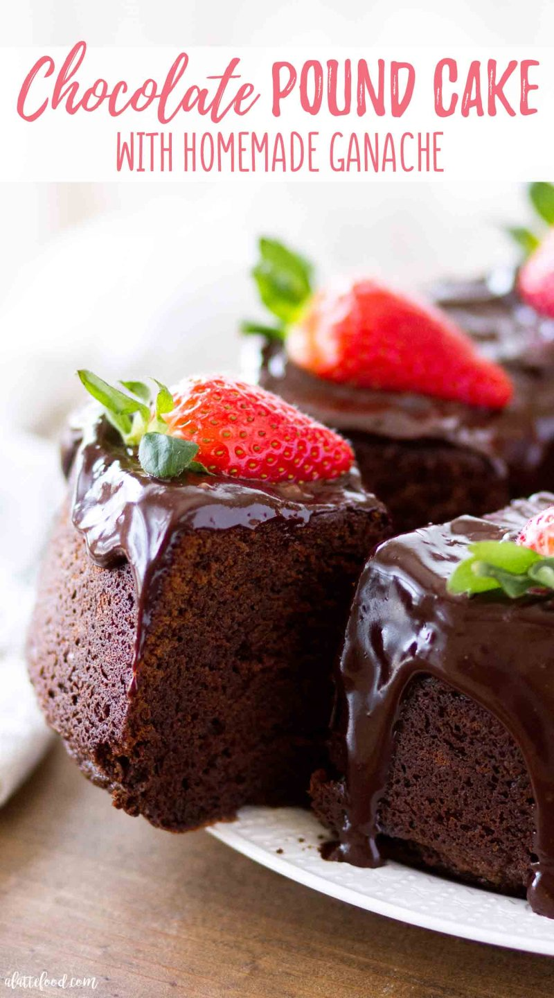 thick slice of chocolate pound cake with ganache and strawberries