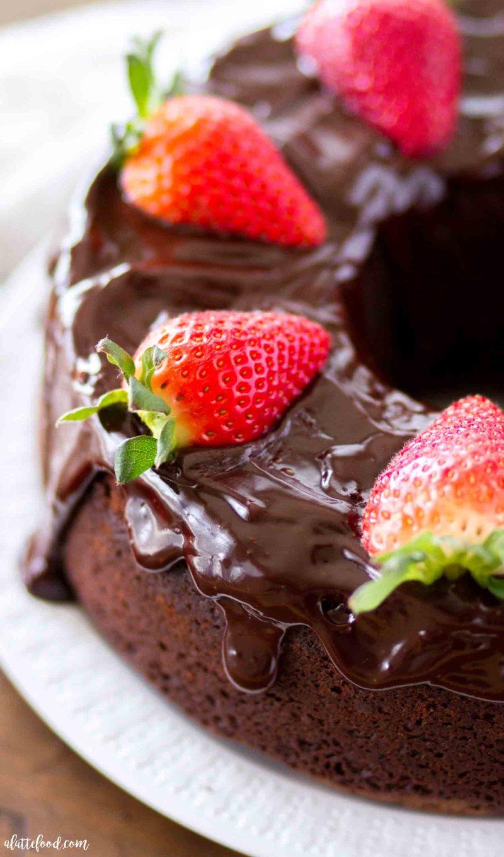 Homemade chocolate pound cake with chocolate ganache and strawberries.