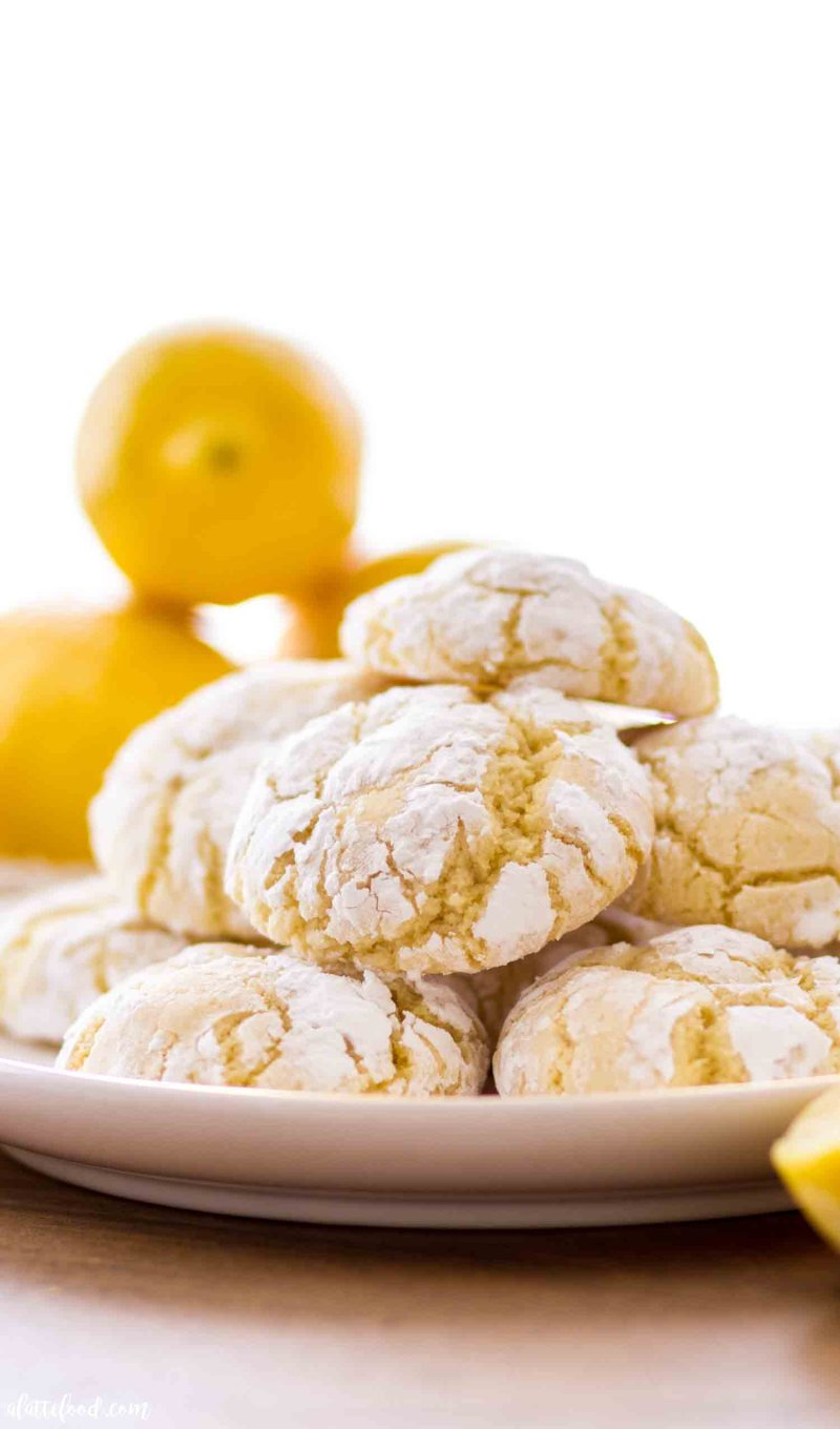 These chewy lemon crinkle cookies with cream cheese are rolled in powder sugar.