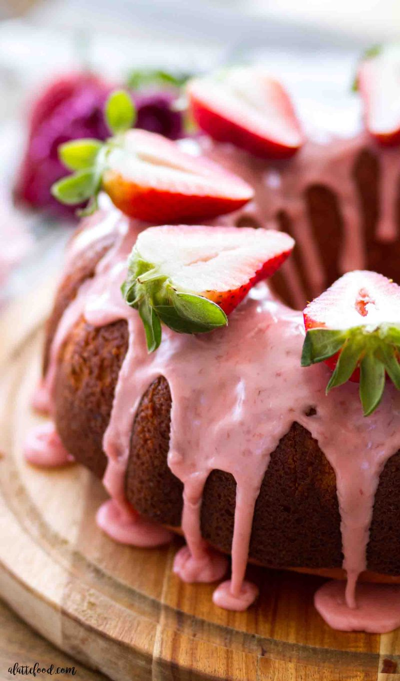 Strawberry bundt cake recipe with homemade strawberry icing and fresh strawberry sauce.