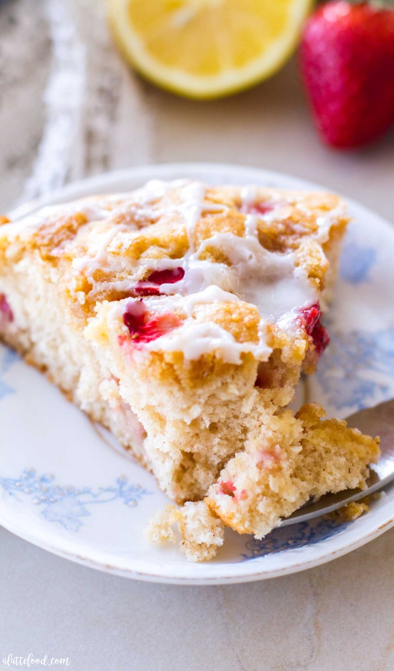strawberry coffee cake with lemon on a blue plate