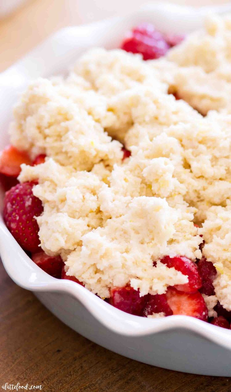 Easy strawberry cobbler with a lemon drop biscuit topping before being baked