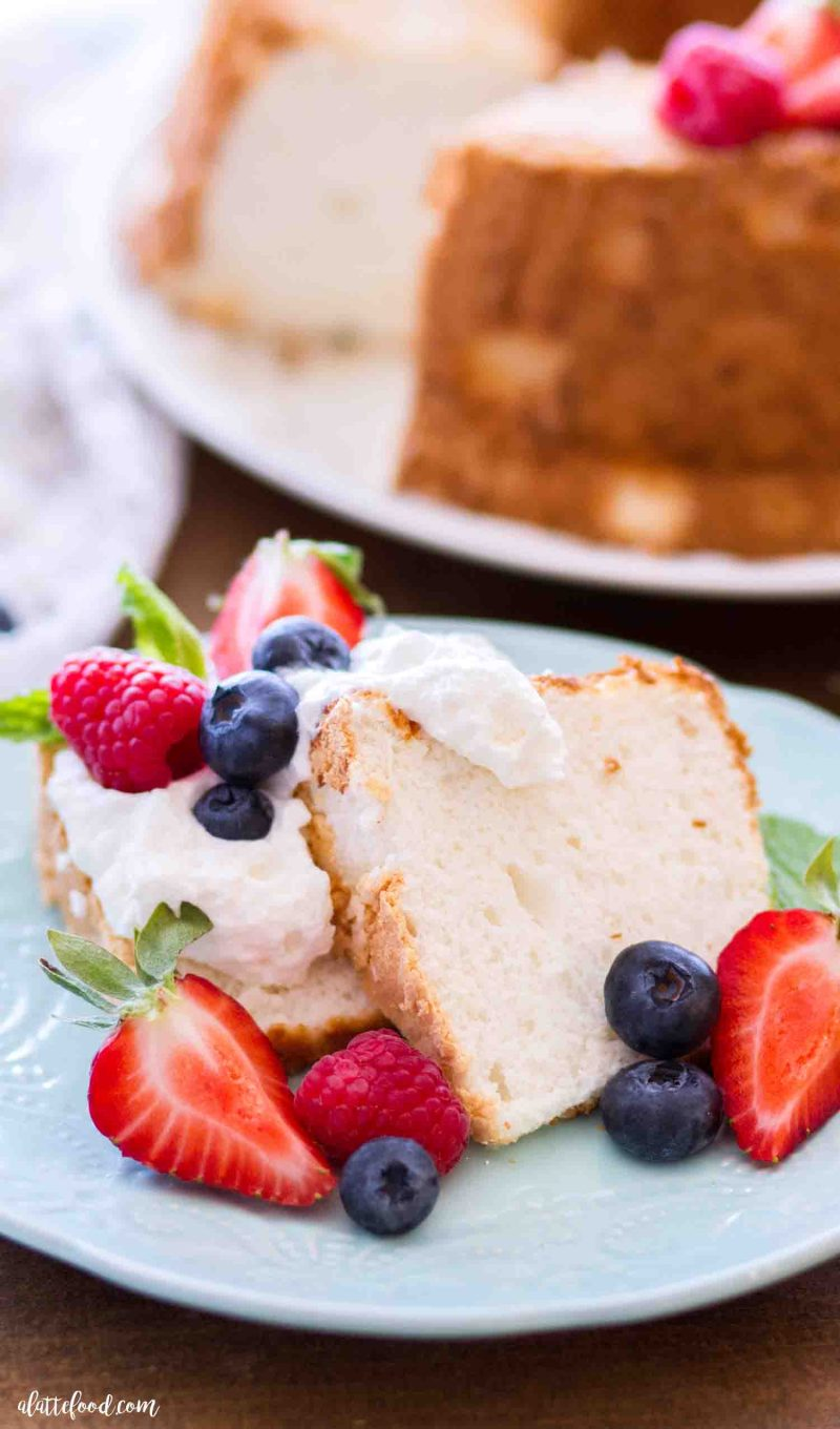 Slices of this homemade angel food cake are made better with fresh berries, homemade whipped cream and fresh mint
