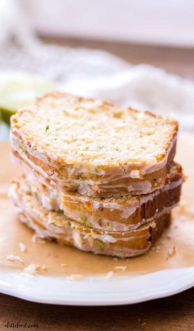 stack of lime coconut zucchini bread on brown parchment paper