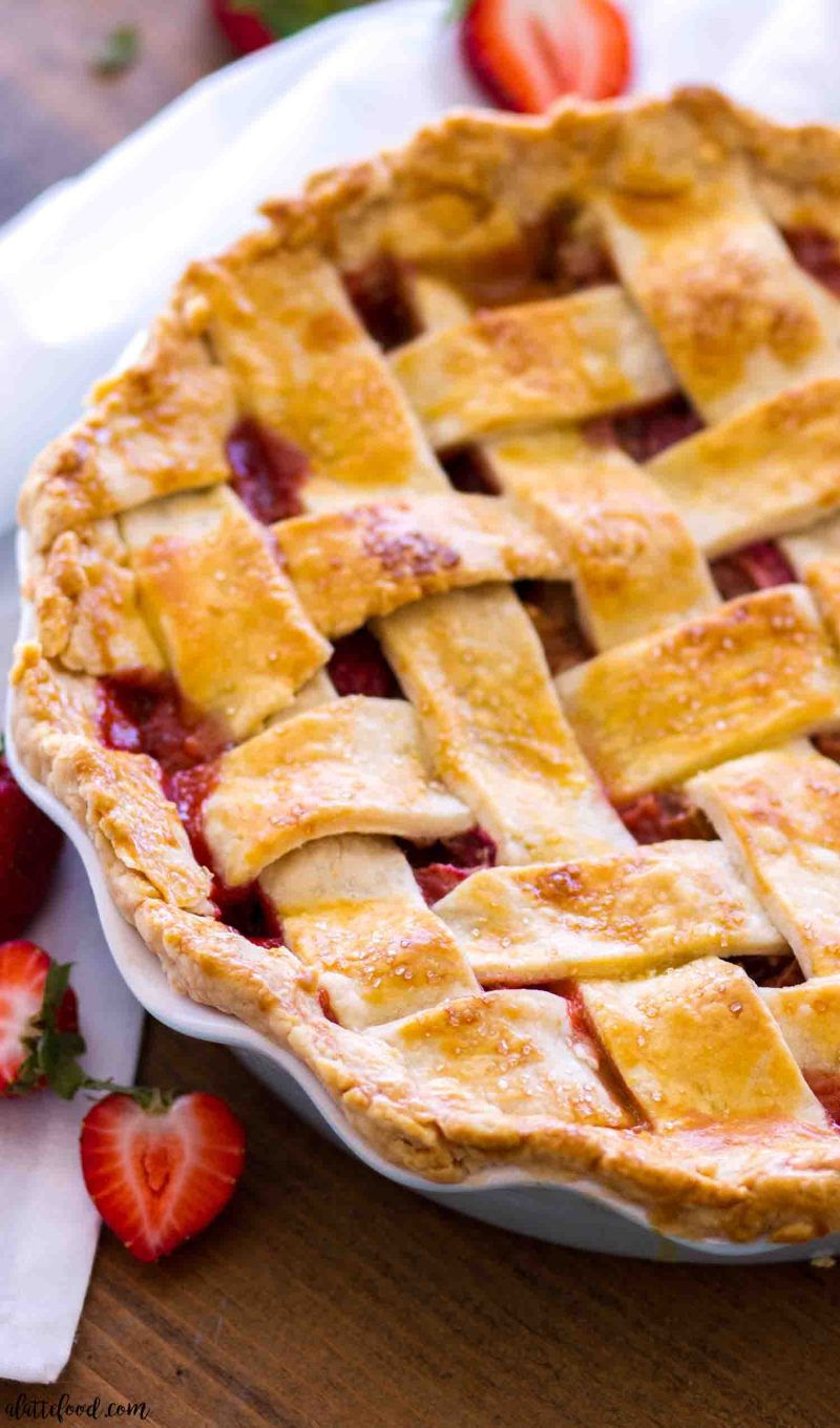 """Easy strawberry rhubarb pie with a lattice crust in a 10"""" pie plate"""