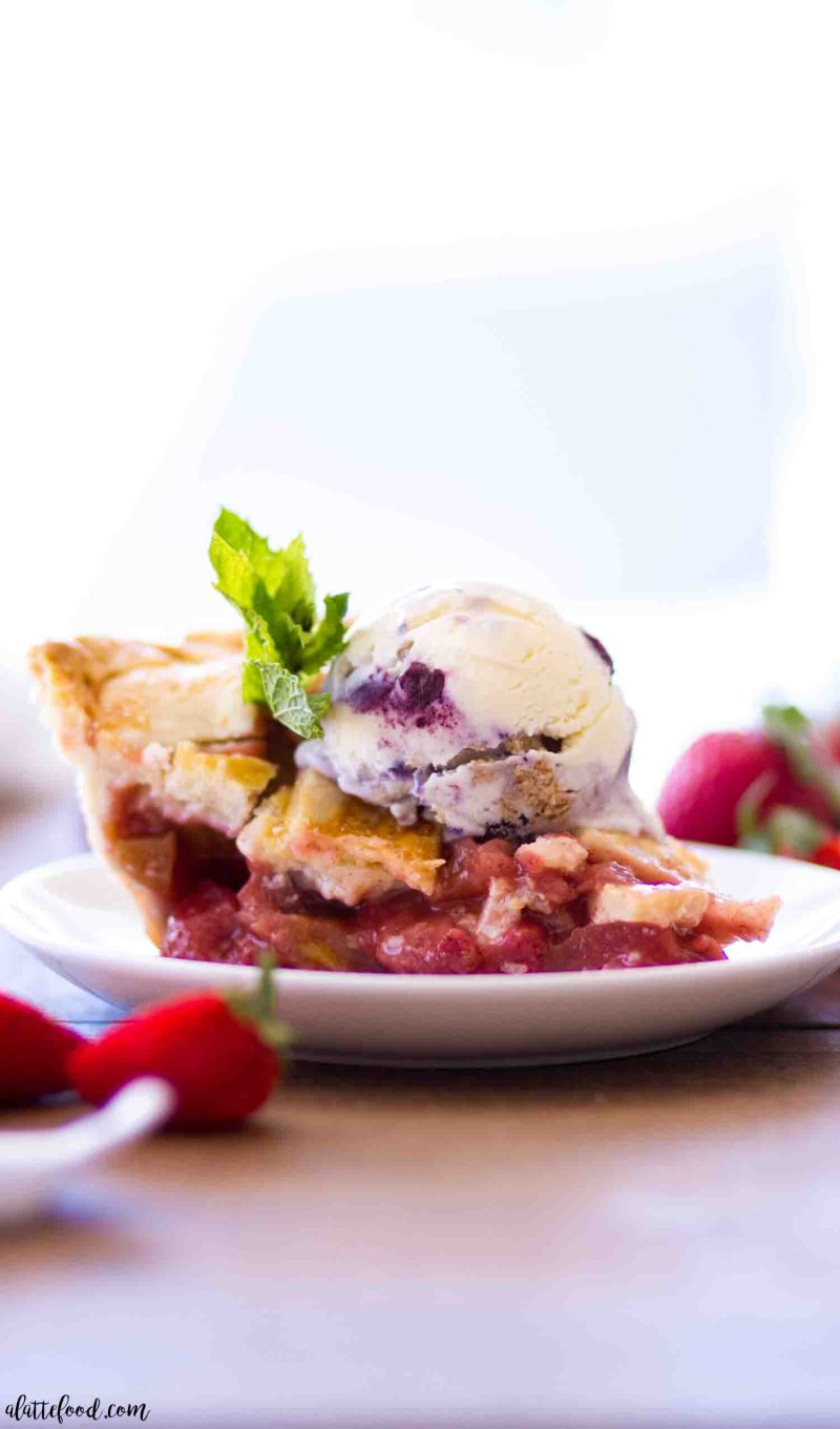 Old fashioned strawberry rhubarb pie with ice cream on top
