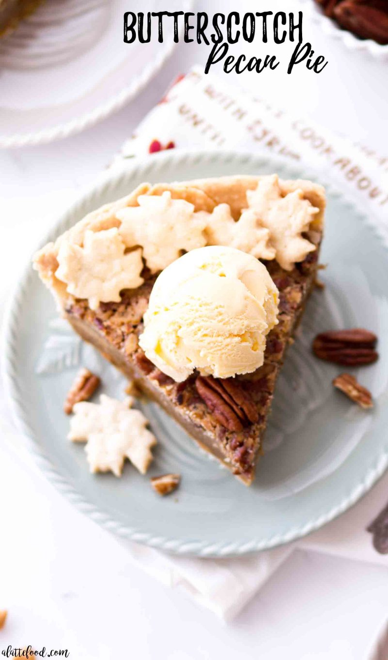 Homemade butterscotch pecan pie with vanilla ice cream on a blue plate