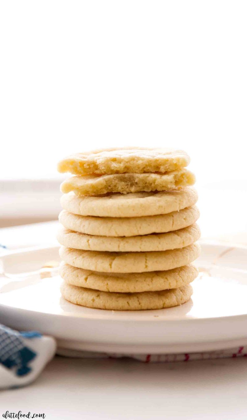 chewy sugar cookies stacked on plate