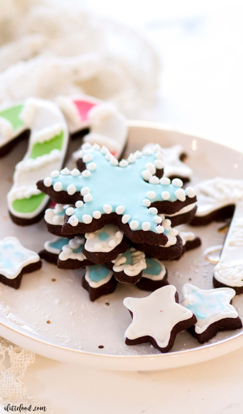 blue royal icing on chocolate sugar cookies