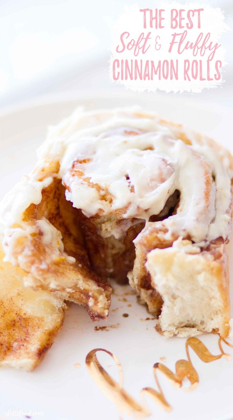gooey cinnamon roll with cream cheese icing on white plate
