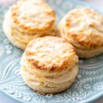 three baked biscuits on a flowered teal plate