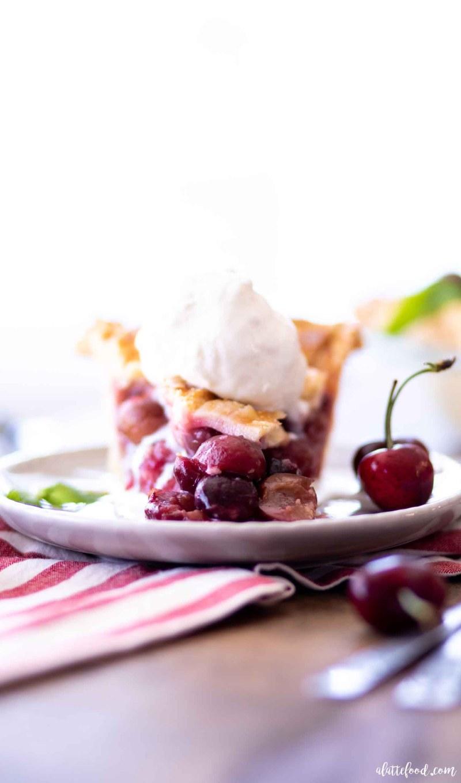 fresh cherry pie topped with ice cream