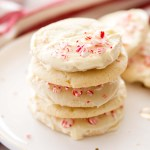 stack of peppermint white chocolate sugar cookies on a white plate