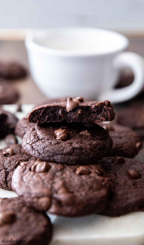 half of fudgy chocolate cookie stacked on top of brownie cookies