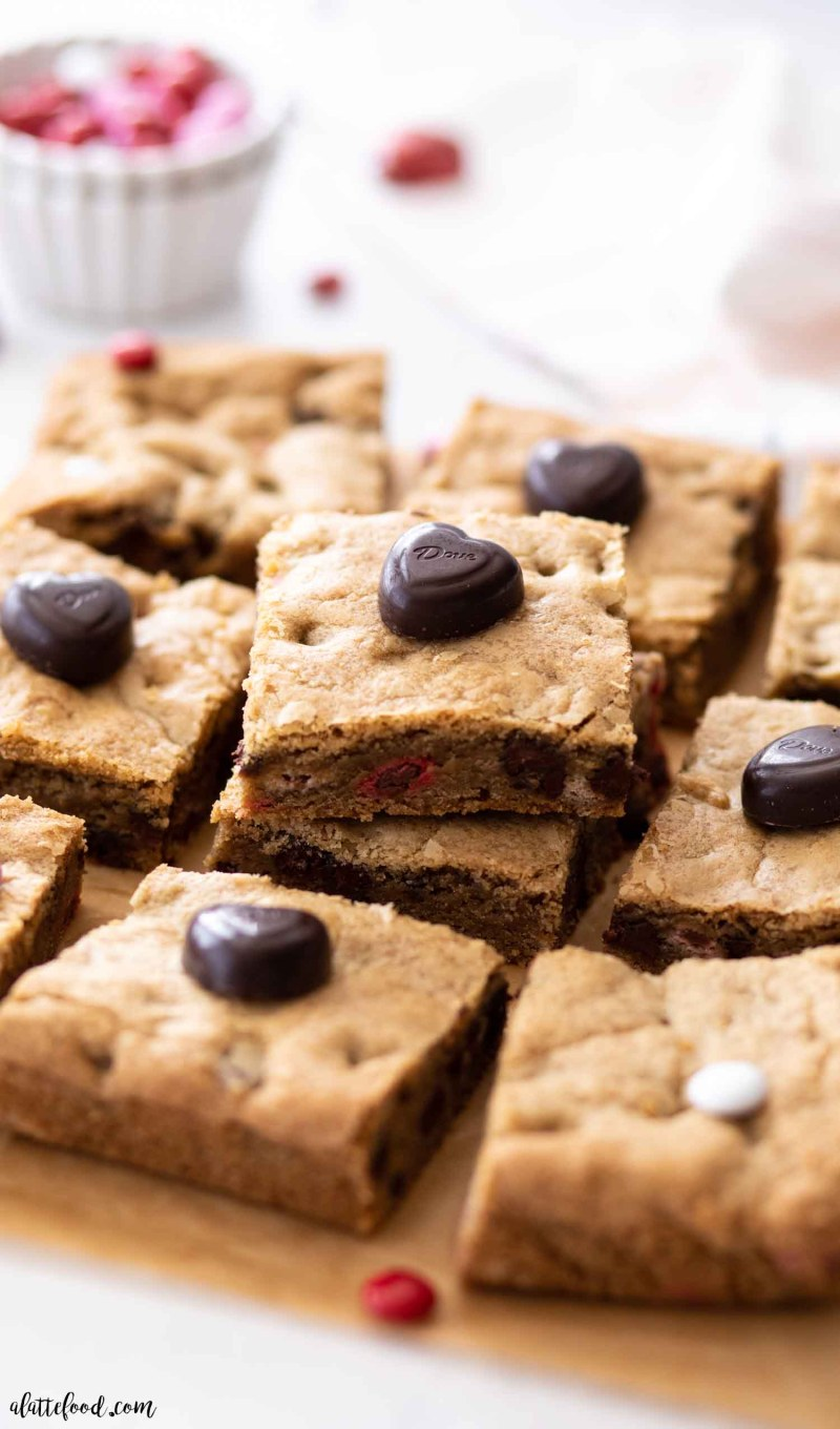 M&M cookie bars on brown parchment paper