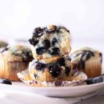 stack of blueberry muffins on white plate