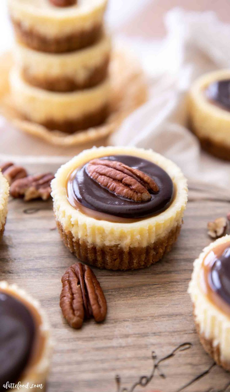 caramel topped mini cheesecakes with ganache and pecans